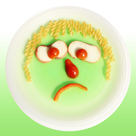 Poor eater, Food face made of noodles, tomato and red pepper