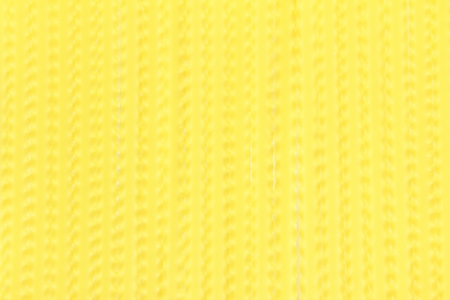 Background of softened wavy yellow noodles photo