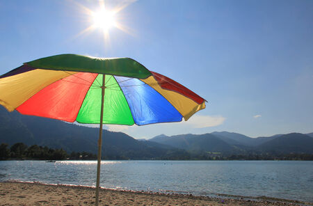 lakeshore: Lake-shore of tegernsee with sunshade in rainbow colors
