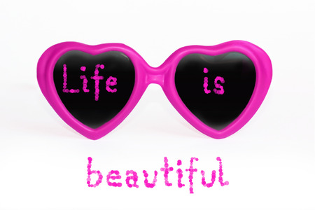 themed: positive thinking text  life is beautiful, attitude towards life, rose madder heart shaped eye glasses with text, isolated on white