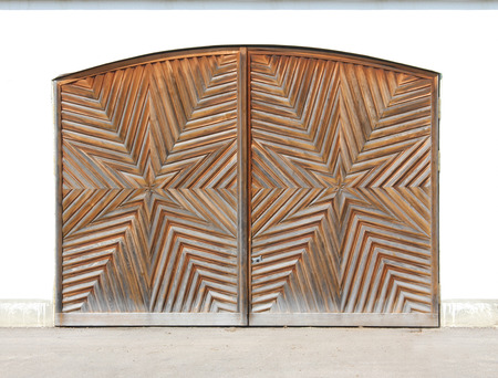 starlike: wooden garage door with star-shaped carving  Stock Photo