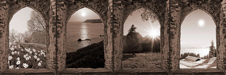 composition of four ruin arched windows with seasonal landscape, retro style  photo