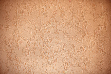 structured: structured wall surface with dark edges, apricot colored background design