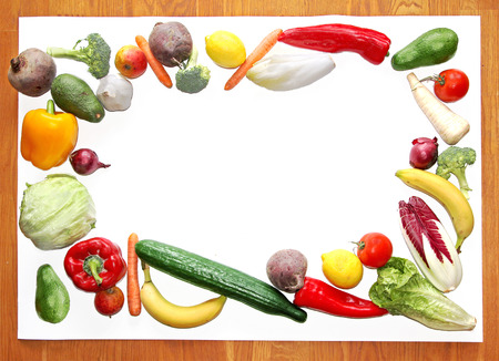 board with fresh vegetable and fruit border  photo