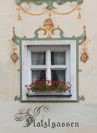 Historic bavarian window, framed with mural painting  photo
