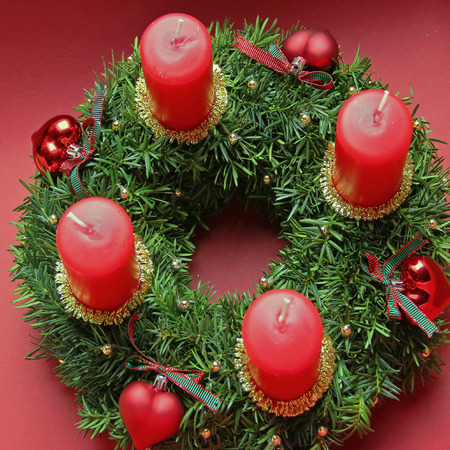 Advent wreath with four red candles, above view  photo