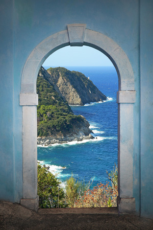 view through door:  View through arched door, beautiful coastal landscape