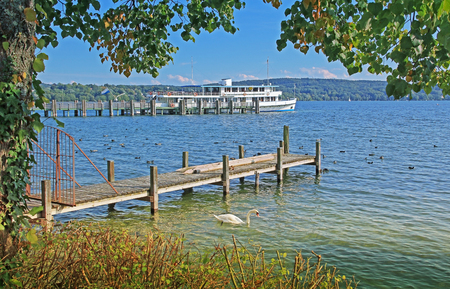 starnberger see: View to starnberger see, boardwalk and steamboat  Stock Photo