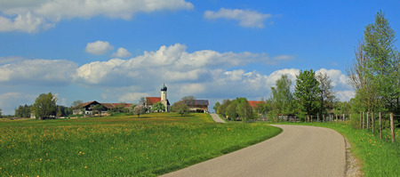 idyllic village with church, bavarian landscape  photo
