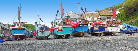fishing boats at the cornish coast, cadgwith village uk photo