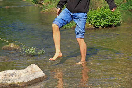 man hardening in a cold brook, kneipp therapy Standard-Bild