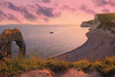 durdle door: moody sunset scenery at durdle door beach, dorset