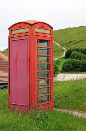 phonebox: old weathered british phonebox at the coast
