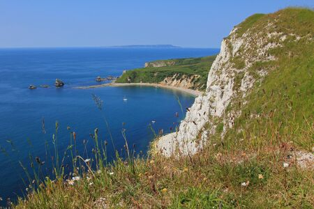 mupe bay: view to mupe bay, lulworth, and steep cliffs, jurassic coast