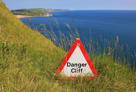 danger cliff - caution sign jurassic coast