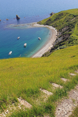 mupe bay: coastal path with view to mupe bay, dorset