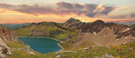 Beautiful panoramic view to lunersee and austrian alps, sunset scenery photo