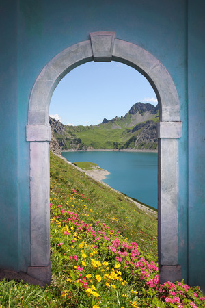 view through door: view through arched door; artificial lake, alpine flowers and mountains