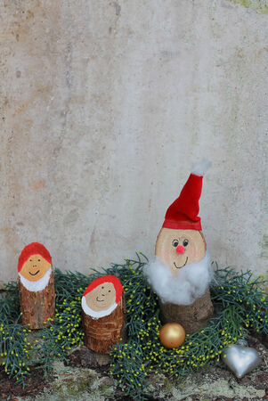 rustic homemade christmas decoration with happy gnomes Stock Photo