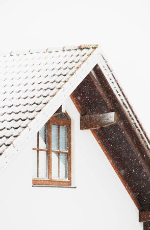 house gable: house gable and roof on a snowy day