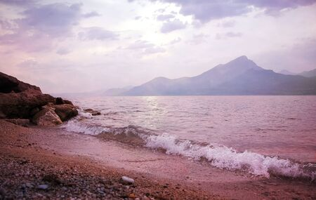 italian landscape: lonely sunset beach at garda lake, italian landscape Stock Photo