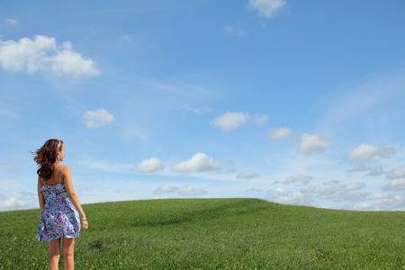 intact: teenage girl looking into natural landscape - intact environment Stock Photo
