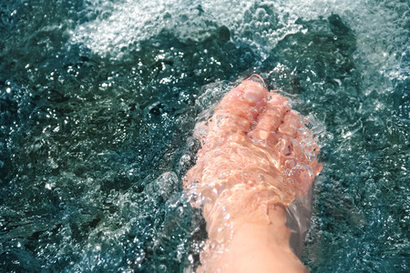hardening: women foot, refreshing and hardening in a cool mountain brook