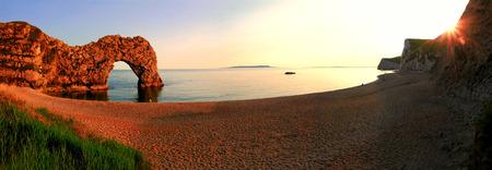 durdle door: romantic sunset scenery at durdle door beach, dorset Stock Photo