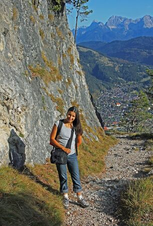 hiking path: mountaineering woman, hiking path garmisch, bavarian alps Stock Photo