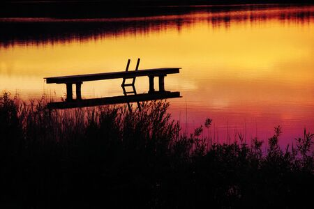 dyllic: romantic scenery with boardwalk at sunset time