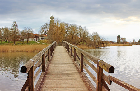 pictorial: wooden bridge in pictorial landscape, lake seeon, germany