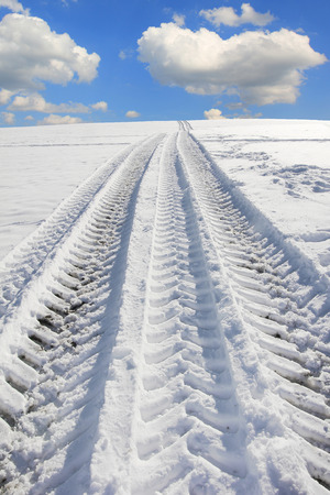 wheel tracks from a truck tire in winter landscape photo