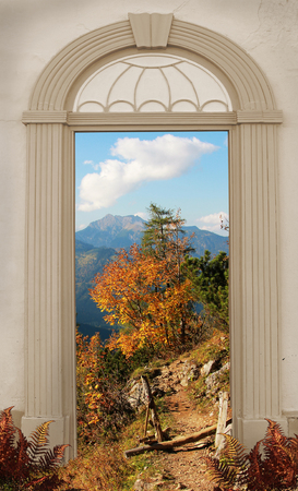 view through: view through arched door autumnal mountain landscape Stock Photo