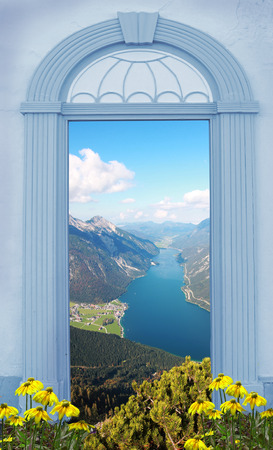 arched: view through arched door Lakeview in the Bavarian Alps Stock Photo