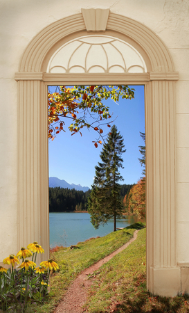 view through: view through arched door autumnal alpine hiking trail at Lakeside Stock Photo