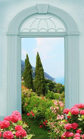 view through door: view through arched door Mediterranean landscape with hydrangeas