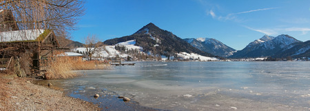 ice sheet: Schliersee lake with sheet of ice German winter landscape Stock Photo