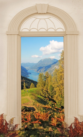 view through door: view through arched door autumnal mountain landscape Stock Photo