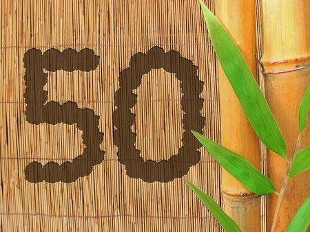 number 50: el n�mero 50 en la pared de bamb�, dise�o de fondo para el jubileo o cumplea�os