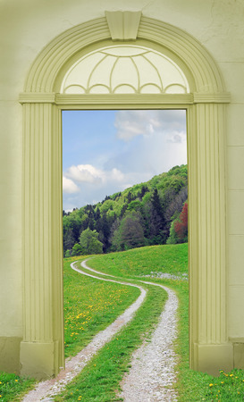 hiking path: view through arched door, hiking path in hilly summer landscape