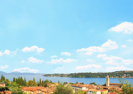 salo: Salo village and garda lake, blue sky background with clouds and copy space