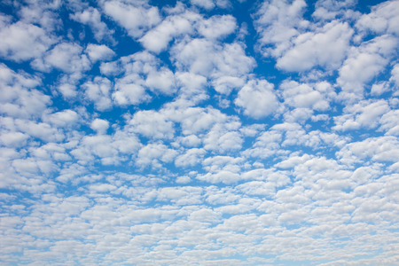 fleecy: blue sky background full of fleecy clouds
