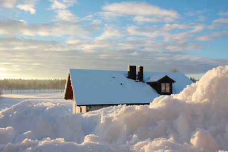 heap of snow: winter morning in the village, view from snowy rooflight through heap of snow Stock Photo