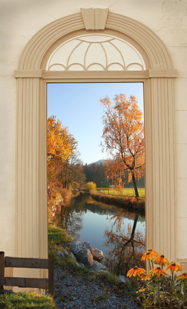 view through arched door, autumnal lakeside path