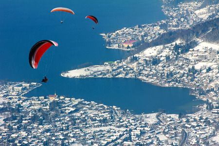 bird's eye view: rottach-egern village, birds eye view, with paragliders, germany