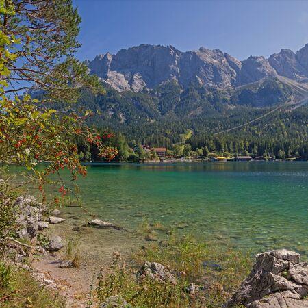 zugspitze mountain: beautiful mountain lake eibsee and zugspitze massif, german tourist destination Stock Photo