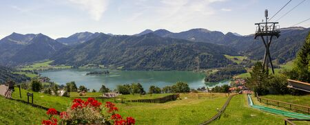 toboggan: lookout from schliersbergalm, lake schliersee, toboggan run and bavarian alps