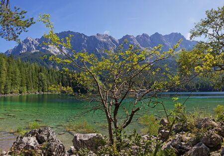 zugspitze mountain: beautiful mountain lake eibsee and zugspitze massif, german landscape