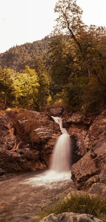 browns: kuhflucht cascades, bavarian mountain torrent in soft browns. Long exposure shot.