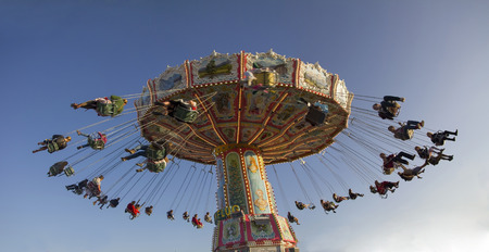 chairoplane: Munich Octoberfest 2. October 2015 - rotating chairoplane with people